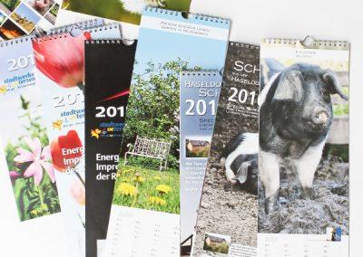 """Diverse Kalender u.a. Stadtwerke Uetersen, """"Sauglücklich"""" aus Haseldorf"""